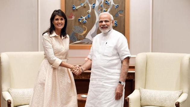 Prime Minister Narendra Modi shakes hands with US Ambassador to the United Nations Nikki Haley before the start of their meeting in New Delhi.(Reuters/PIB)