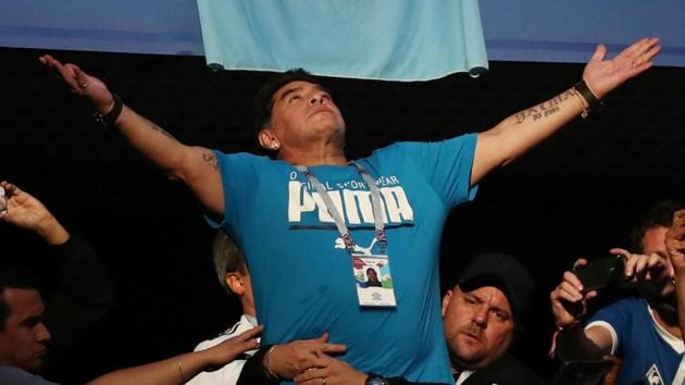 Fans take photos of Diego Maradona in the stands during Argentina's FIFA World Cup 2018 game against Nigeria on Tuesday.(REUTERS)
