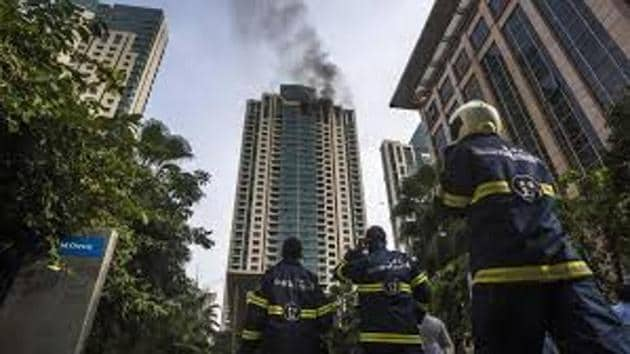 The fire engulfed the top three floors of the high-rise.