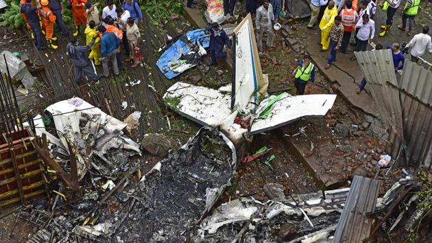 Forensic experts, fire department personnel and a dog squad inspect the crash site of a chartered plane at Old Malik Estate, Jeev Daya Lane, Ghatkopar, in Mumbai on June 28, 2018.(Vijayanand Gupta/HT Photo)