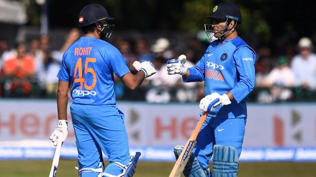 India's Rohit Sharma and MS Dhoni celebrate during the first T20 match against Ireland in Dublin on Wednesday.(REUTERS)