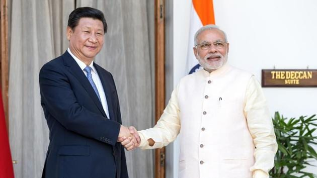 Prime Minister Narendra Modi, right, shakes hands with Xi Jinping, China's president, as they arrive for delegation talks at Hyderabad House in New Delhi, India, on Thursday, September 18, 2014.(Graham Crouch/Bloomberg)
