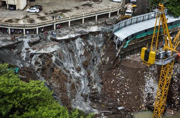 The landslide occurred during heavy rainfall on Monday.(Satish Bate/HT Photo)
