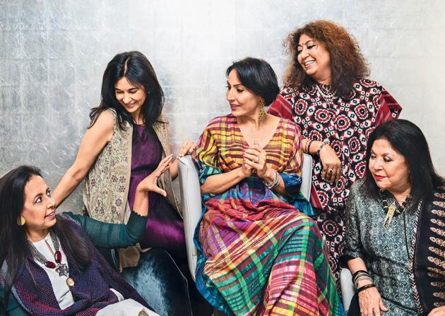 (From left) Anju Modi wears Banarasi cutwork palazzos, a chanderi kurta and bandhani cape, jewellery plus shoes (not seen in this picture) all from her own collection; Kavita Bhartia wears a crinkled garnet-hued silk dress with beige textured-hand block printed cape from her own collection and pearl earrings by Dior; Krishna Mehta wears a handwoven silk kaftan from her own brand, jewellery from Le Mill and shoes (not seen in this picture) by Stuart Weitzman; Madhu Jain wears an Uzbek bamboo silk Ikat choga, dupatta and loose pyjamas from her own brand and a South Sea pearl string; Ritu Kumar wears an ajrakh printed suit and skirt from her own brand and an antique mangalsutra from Coorg (Location courtesy: Roseate House, New Delhi; Art direction: Amit Malik; Assisted by: Ishaan Ishitava; Make-up and hair: Ambika Pillai Designer Salon)(Naina Redhu)