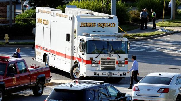 Emergency response vehicles drive near a shooting scene after a gunman opened fire at the Capital Gazette newspaper in Annapolis, Maryland, U.S., June 28, 2018.(REUTERS)