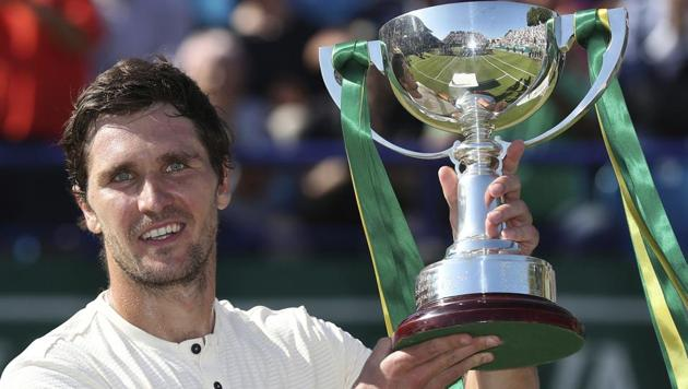 Mischa Zverev holds the winners trophy after beating Lukas Lacko in Eastbourne on Saturday.(AP)