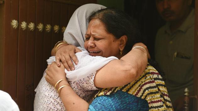 Relatives mourn outside the house, where 11 members of a family were found dead inside their home in north Delhi's Sant Nagar near Burari on Sunday morning, in New Delhi on July 1, 2018.(Raj K Raj/HT Photo)