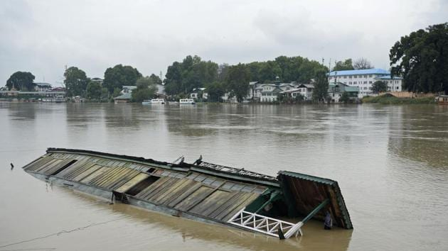 A partially submerged houseboat is seen in Jhelum river after heavy rain in Srinagar.(AFP FILE PHOTO)