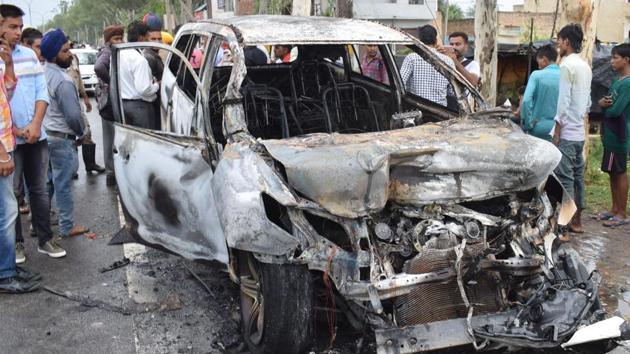 The Innova car caught fire on the Patiala-Rajpura road on Monday(HT Photo)