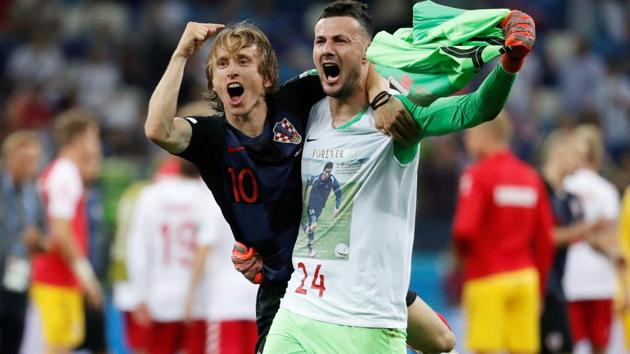 Croatia's Danijel Subasic celebrates with Luka Modric after winning the penalty shootout against Denmark in FIFA World Cup 2018 on Sunday.(REUTERS)