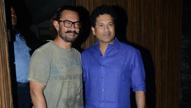 Aamir Khan and Sachin Tendulkar pose for the camera after the dinner party at the actor's home on Monday.(Viral Bhayani)