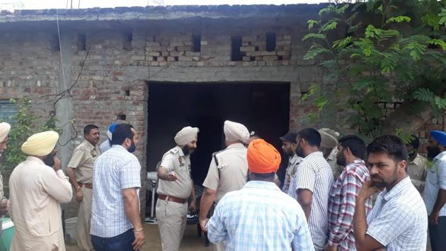 Police personnel examining the house where the three women were found murdered on Thursday.(HT Photo)