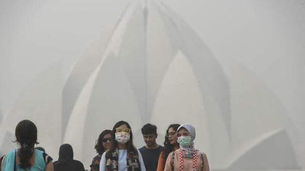 Tourists wear masks as they visit Delhi's Lotus Temple. Last month, Delhi recorded days of the worst air quality it has ever had(Burhaan Kinu/HT PHOTO)