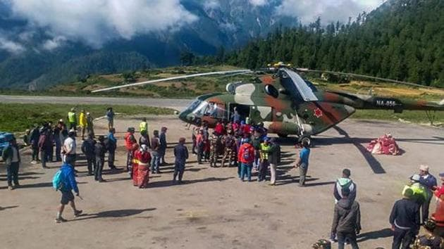 Indian pilgrims being evacuated from Simikot to Surkhet and Nepalganj, as authorities stepped up efforts to rescue those stranded there due to heavy rain while returning from the Kailash Mansarovar pilgrimage in Tibet in Simikot on July 4.(PTI Photo)