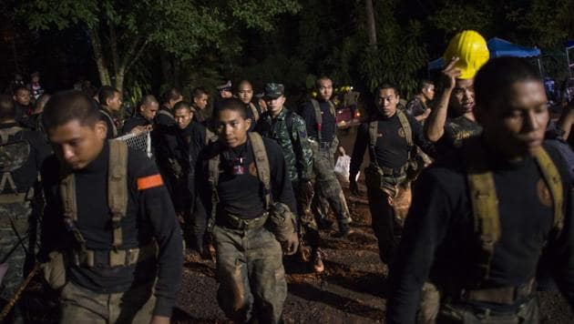 Thai soldiers are seen at the Tham Luang cave area as operations continue for the 12 boys and their coach trapped at the cave in Khun Nam Nang Non Forest Park in the Mae Sai district of Chiang Rai province on July 6.(AFP Photo)