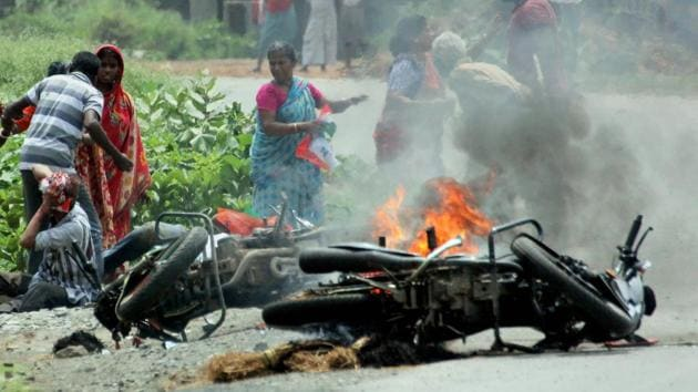 A vehicle is set on fire during the violence that erupted during the recently held panchayat elections in West Bengal. To understand the scale of local political violence, it is important to understand the state's political structure.(PTI File Photo)