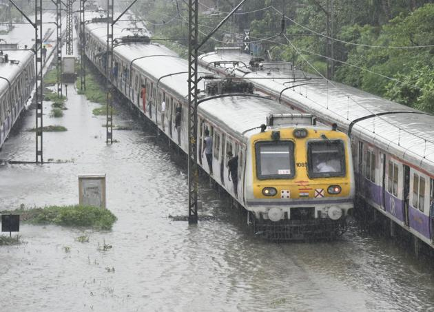 Tracks were submerged between Matunga and Sion stations on Monday as rains lashed the city.(Kunal Patil/HT)