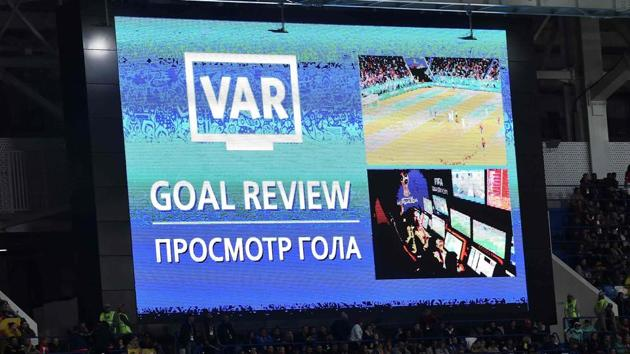 A screen displays the VAR goal review confirming Spain's second goal during the FIFA World Cup 2018 match against Morocco.(AFP)