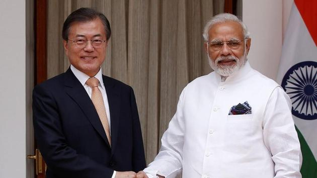 South Korean President Moon Jae-in shakes hands with Prime Minister Narendra Modi ahead of their meeting at Hyderabad House in New Delhi, on Tuesday.(REUTERS)