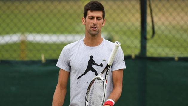 Novak Djokovic practices at the training courts on the eighth day of the 2018 Wimbledon Championships.(AFP)