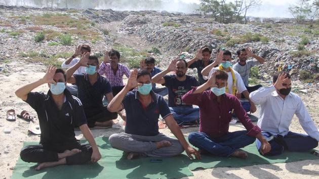 On June 21, on the occasion of the world yoga day, residents of the area had conducted yoga at the trenching ground wearing masks to highlight their plight.(HT File)