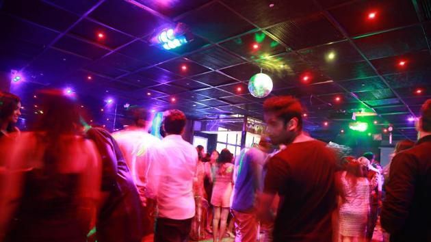 Single women are being denied entry into pubs and nightclubs on MG Road in Gurugram after the police conducted raids in the area on July 3 to check alleged solicitation and immoral trafficking.(Shivam Saxena/HT)
