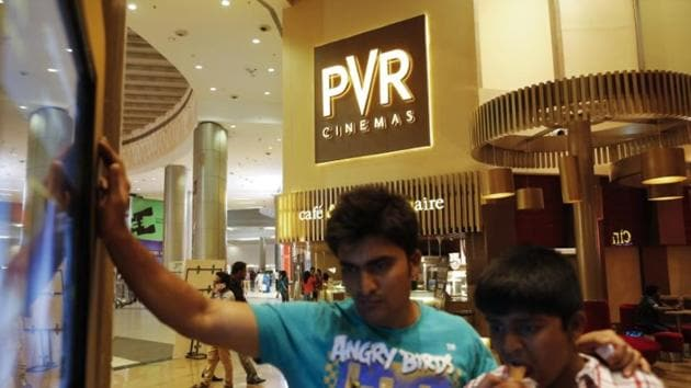 Cinema-goers watch a movie trailer at a PVR Multiplex in Mumbai(Reuters File Photo)