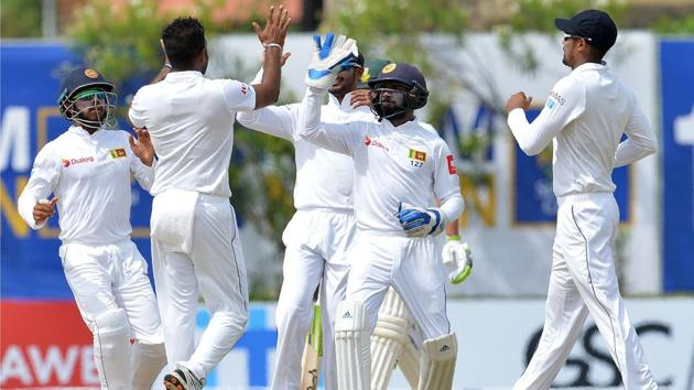 Sri Lanka players celebrate after dismissing South Africa for 126 during the second day of the opening Test at the Galle International Cricket Stadium on Friday.(AFP)