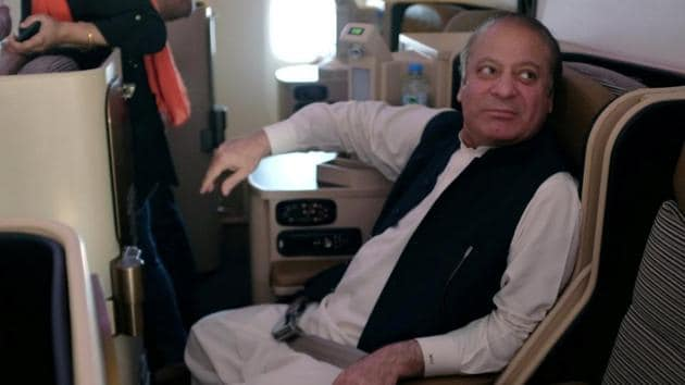 Ousted Pakistani Prime Minister Nawaz Sharif sits on a plane after landing at the Allama Iqbal International Airport in Lahore, Pakistan, July 13, 2018.(REUTERS)