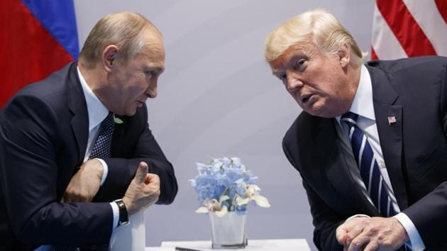 US president Donald Trump with Russian president Vladimir Putin at the G-20 Summit on July 7, 2017, in Hamburg. The summit between Trump and Putin will go ahead as planned on Monday, the White House has said.(AP Photo)