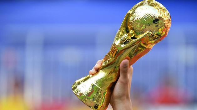 A replica of the FIFA World Cup trophy is brandished by a football fan before a Russia 2018 World Cup football match in Moscow.(AFP File Photo)