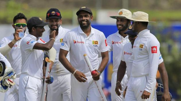 Sri Lanka's Dilruwan Perera, center, is congratulated by his team members after they defeated South Africa in Galle on Saturday.(AP)