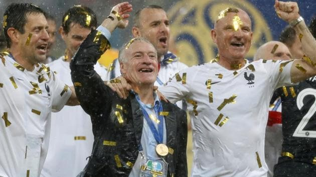 France coach Didier Deschamps celebrates with France staff after winning the World Cup 2018 title on Sunday.(REUTERS)