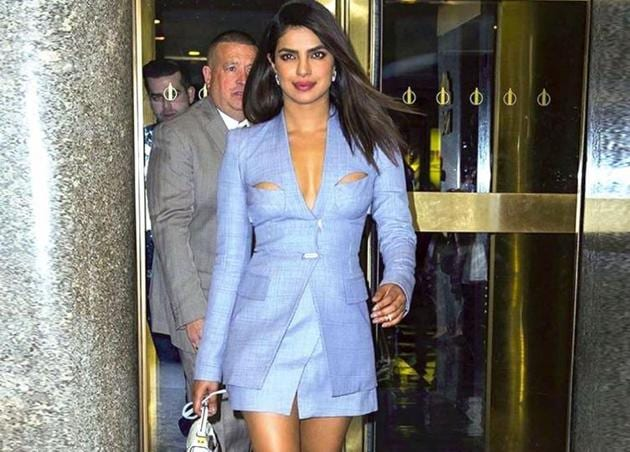 Think a skirt suit can't be sexy? Think again. Priyanka Chopra proves the professional-looking outfit can be surprisingly alluring, with some interesting styling tips. (Instagram)