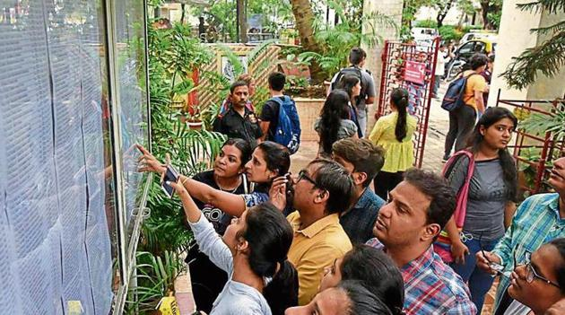 Students checking the first merit list at HR college in Churchgate last week.(Kunal Patil/HT Photo)