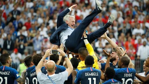 France's coach Didier Deschamps is thrown in the air after the final whistle of the FIFA World Cup 2018 final against Croatia at the Luzhniki Stadium in Moscow.(AFP)