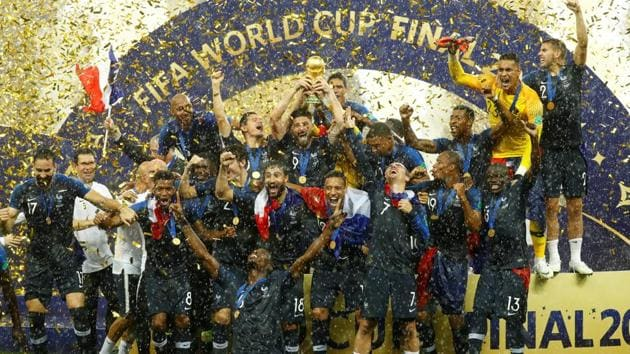 <p>France players celebrate with the trophy after winning the World Cup 2018 title.</p> (REUTERS)