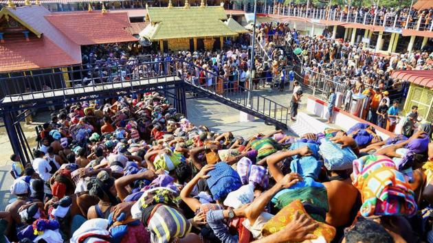 Devotees gather at the Sabarimala temple in Pathanamthitta, Kerala.(PTI File Photo)