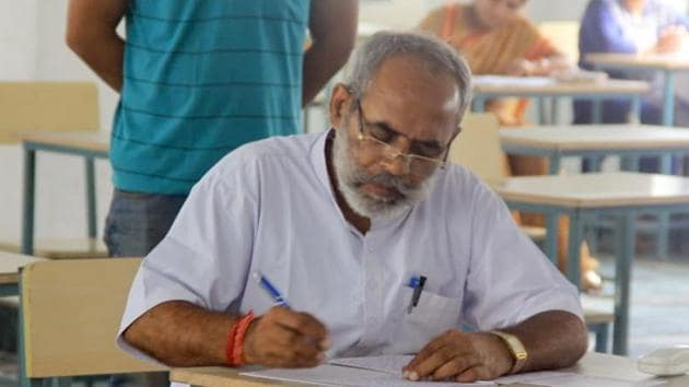 BJP MLA Phool Singh Meena is appearing for his BA first year exams. He had to drop out of school to take care of his family.(HT Photo)