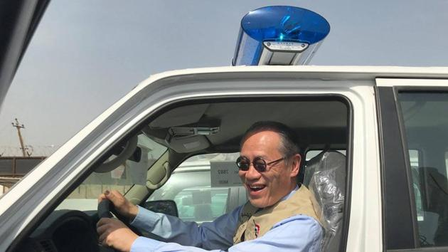 Japanese ambassador Fumio Iwai riding in a pick-up truck during a handover ceremony of vehicles provided by Japan to the Iraqi police at an unspecified location in Iraq.(AFP/Facebook page of the Embassy of Japan to Iraq)