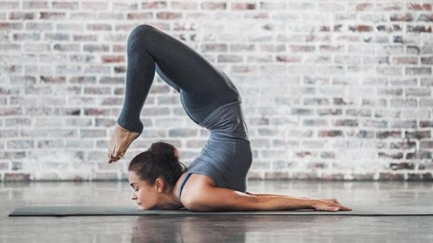 Stop weight gain: Yoga is one of the simplest exercises you can do while holidaying.(Getty Images)