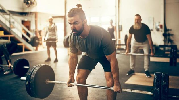 Just by lifting weights you're not going to turn into a beefy, muscle-bound hulk.(Shutterstock)