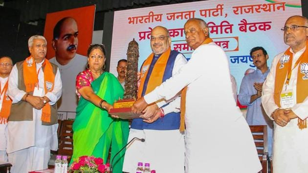Bhartiya Janta Party president Amit Shah with Rajasthan chief minister Vasundhara Raje during the closing ceremony of state working committee meeting, in Jaipur on July 21.(PTI Photo)