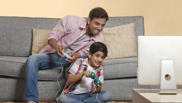 The children received video games and were asked to play these at home with a friend or family member for six months. The study found that the kids who played the games and followed it up with an exercise routine reported weight loss and lower blood pressure.(Shutterstock)