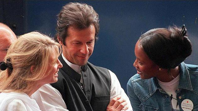 (FILES) In this file photo taken on September 27, 1997, Pakistani cricketer turned politician Imran Khan (C) looks on as his then-wife Jemima Khan speaks with supermodel Naomi Campbell (R) during an event for the arrival of the Blue Train in Cape Town.(AFP)