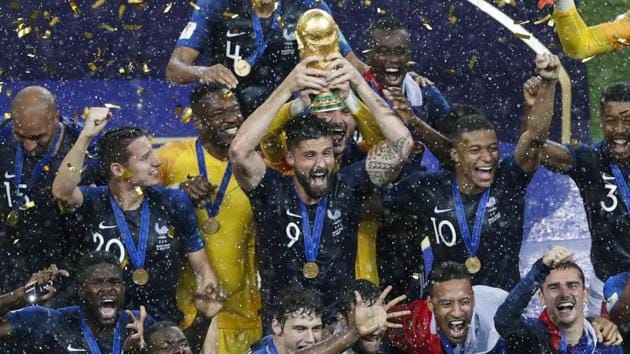 France's Olivier Giroud holds up the trophy as he celebrates with teammates at the end of the final match against Croatia.(AP)