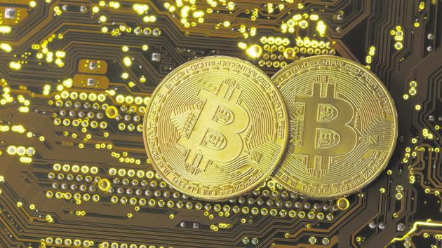 Copies of bitcoins standing on PC motherboard are seen in this illustration picture.(REUTERS File Photo)