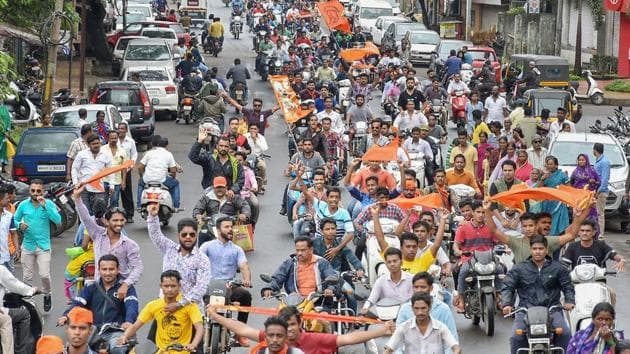 Maratha community members take part in a bike protest rally against the government demanding reservation in Kolhapur on Tuesday.(PTI Photo)