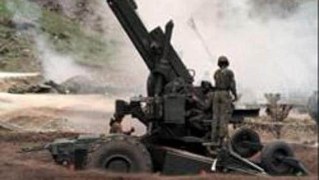 (FILES) A photo dated 21 June 1999 shows Indian artillery men firing 155mm Bofors guns at enemy positions from a gun emplacement on the Srinagar to Kargil road. We haven't added a gun in that category since, in 31 years.(AFP)