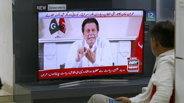 Cricket star-turned-politician Imran Khan, chairman of Pakistan Tehreek-e-Insaf, gives a speech as he declares victory in the general election in Islamabad, Pakistan.(AP Photo)